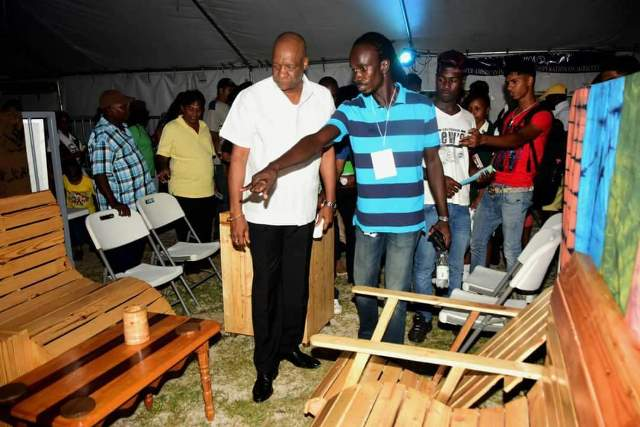 [Picture from 2018] Minister of State Joseph Harmon examines furniture built by PLC Students from Den Amstel.