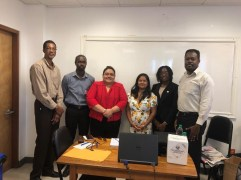 From left to right: Dr. Cyril Giddings- Laboratory Director, National Public Health Reference Lab (NPHRL); Mr. Glendon Fegenay- Deputy Permanent Secretary- (Finance), Ministry of Public Health (MoPH); Ms. Joyce Whyte-Chin- National Focal Point Laboratory Biosafety and Biosecurity, (MoPH); Ms. Sacha Wallace-Sankarsingh, Biorisk Manager, CARPHA; Ms. Whitney Arneaud- Biosafety Technologist, CARPHA & Dr. Julian Amsterdam- Director, Standards and Technical Services, MoPH