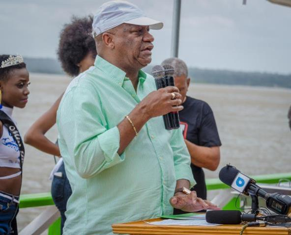 Minister of State, Joseph Harmon addressing the crowd at the official opening of the Bartica Regatta.