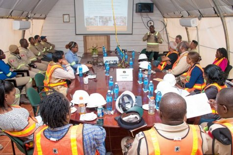 Officials from the Guyana Geology and Mines Commission (GGMC), Guyana Gold Board (GGB), Environmental Protection Agency (EPA) and members of the media, during a safety brief at Aurora Gold Mine before a planned tour of the Cuyuni/ Mazaruni mining operation.