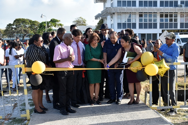 Prime Minister, Moses Nagamootoo, Deputy Vice-Chancellor, Paloma Mohamed and Sylvia Sobhraj cut the ribbon to officially open the centre.