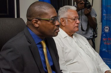Minister of Public Infrastructure, David Patterson and Minister of Agriculture, Noel Holder.