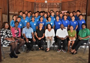 First Lady, Mrs. Sandra Granger (seated, fourth from right), Principal of the Bina Hill Institute, Dr. Laureen Pierre (seated, fifth from right), Regional Executive Officer, Mr. Carl Parker (seated third from left) along with the facilitators of the BIT -ICT training. The participants are pictured standing.