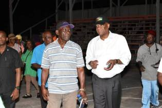 Minister of State, Mr. Joseph Harmon listens to a resident as he makes a point during the community meeting at the Fyrish Basketball Court.