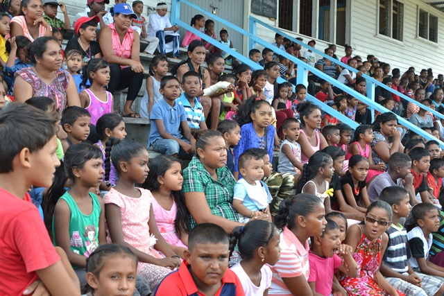 Children waiting to receive kites at Meten-Meer-Zorg, West Coast of Demerara (WCD).