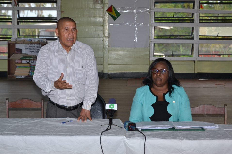 - Minister of Social Cohesion, Dr. George Norton and Minister within Ministry of Public Health, Dr. Karen Cummings speaking to Bath residents.