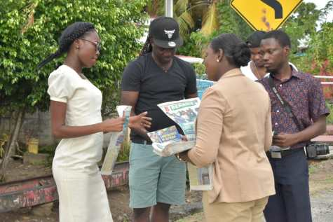 Minister Henry chats with young residents of Central Mahaicony