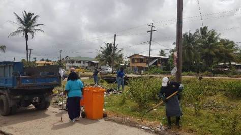 Residents of New Amsterdam participating in the cleanup campaign.