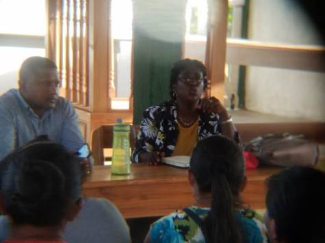 Schools Welfare Officer, Mr. Vickram Mohabir and Ms Nadia Hollingsworth Coordinator of the Parent Teachers Association Unit speaking with the parents yesterday.
