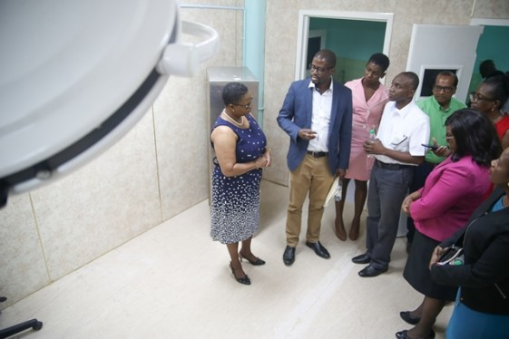 Regional Health Officer, Dr. Desmond Nicholson briefs team from Ministry of Public Health including ministers on progress regarding the reintroduction of surgical services at the Mahaicony Hospital.