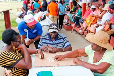 Some of the elderly enjoying domino at the fun-day.