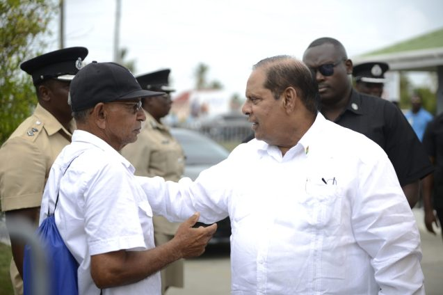 Prime Minister, Moses Nagamootoo greets a resident of Region 6
