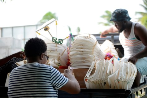 Packing out kites for distribution at the APNU+AFC Office on East Ruimveldt Front Road before walk about.