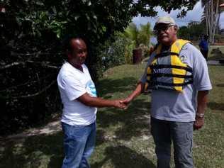 Minister Holder greeted by DeVeldt Village leader