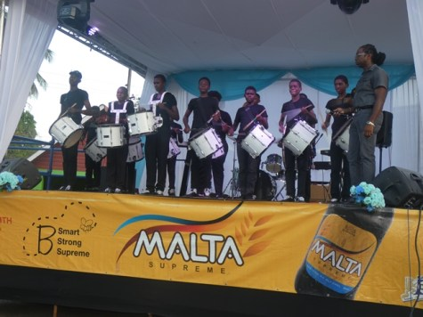 The Linden Constabulary Youth Band doing a drum performance for the audience.