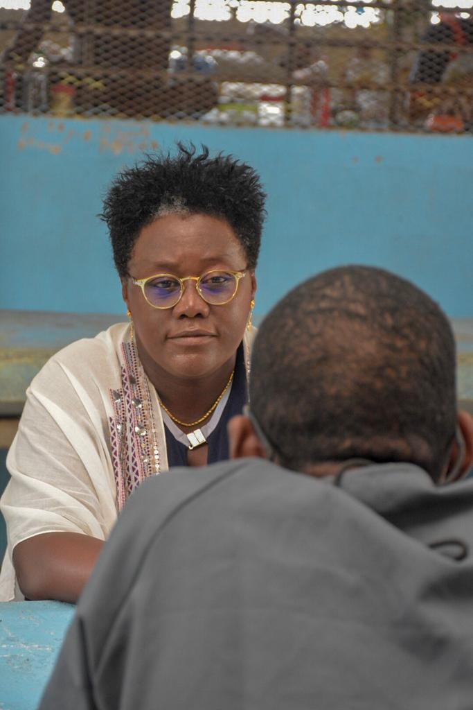 Minister Broomes listens attentively to a young inmate at the Timheri Prison
