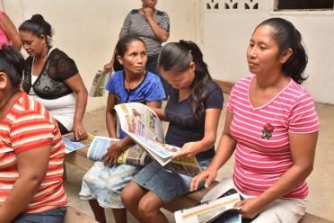 Ladies of Rincon, Moruca speaking with Minister Valerie Garrido-Lowe.