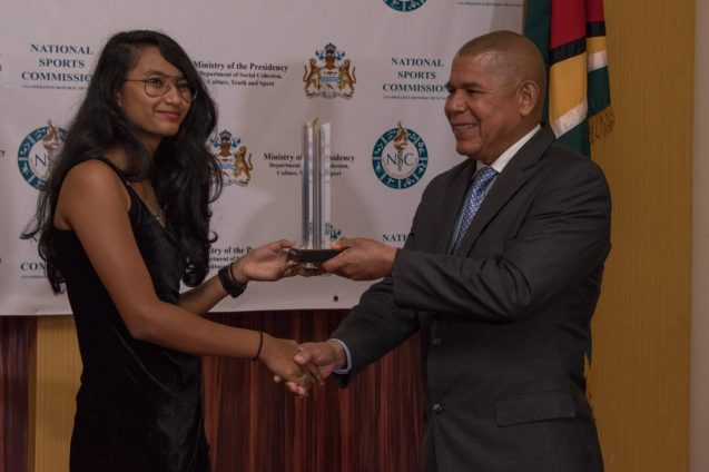 Junior Sportswoman of 2018 - Priyanna Ramdhani receiving her award from Minister of Social Cohesion, with responsibility for Culture, Youth and Sport, Dr. George Norton.