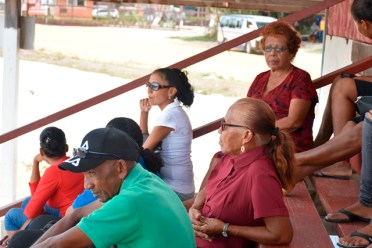A section of the gathering, including opposition Member of Parliament (MP), Yvonne Pearson, listens attentively to MP Mervin Williams, during his address to Indigenous communities in Region 2.