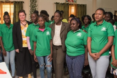Education Minister, Dr. Nicolette Henry along with some of the reintegrated mothers.