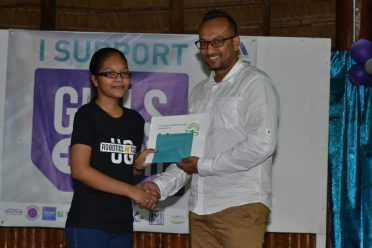 First and Second place awardees for Essay competition (Girls and technology can change Guyana: The change I want to see in my community)