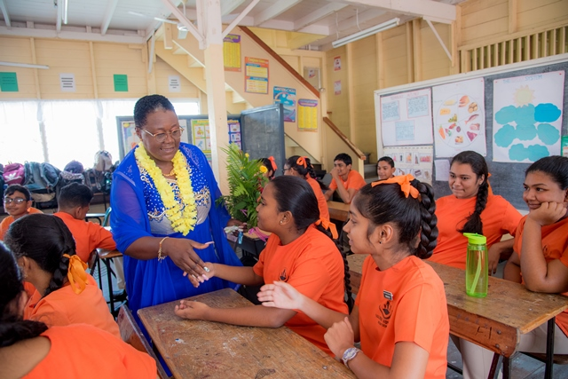 Minister with responsibility for Youth Affairs, Simona Broomes interacting with students.