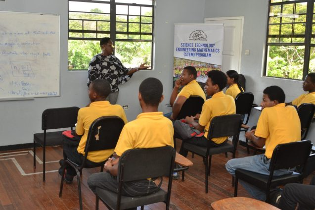 Minister within the Ministry of the Presidency with responsibility for Youth Affairs, Simona Broomes, speak with students during a visit to the Volunteer Youth Corps earlier today