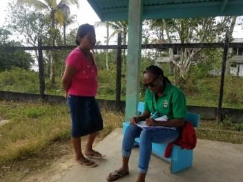 General Registrar Office officer in green facilitating the registration of births at Morashee.