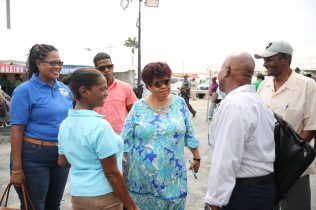 Minister of Social Protection Amna Ally engaging a patrons