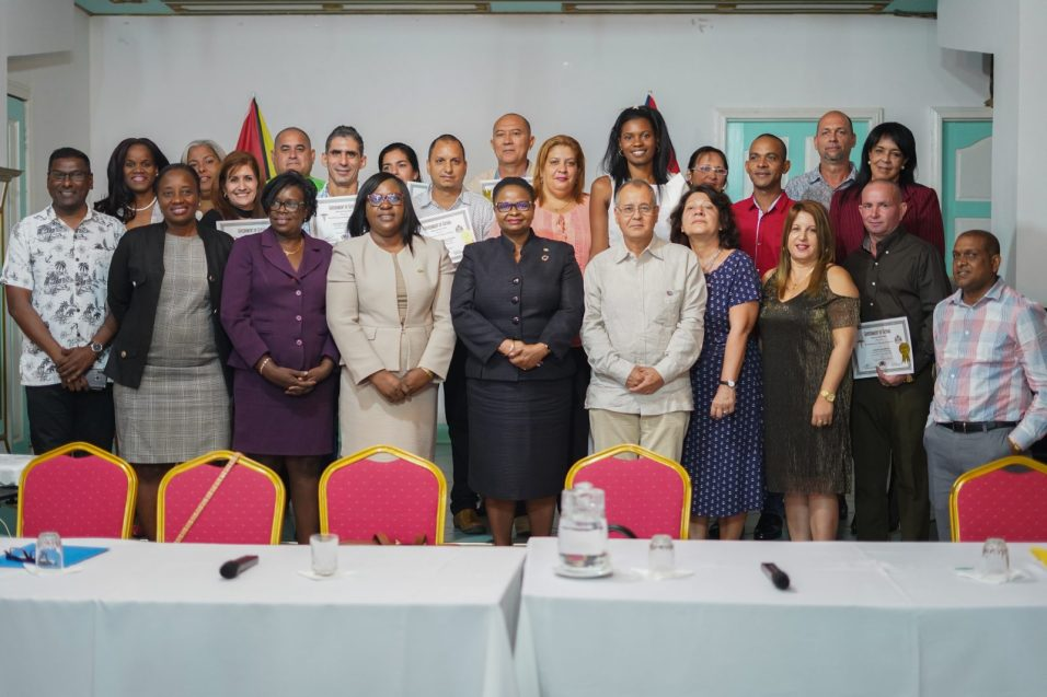 Minister of Public Health Volda Lawrence and Minister within the Ministry Dr. Karen Cummings along with senior officials, the 14 doctors from Cuba and the Cuban Ambassador to Guyana