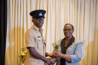 A member from the Guyana Police Force receiving an award for implemented Occupational Safety measures