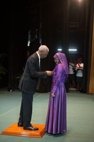 H.E President David Granger confers the Medal of Service insignia on Shameza Baksh