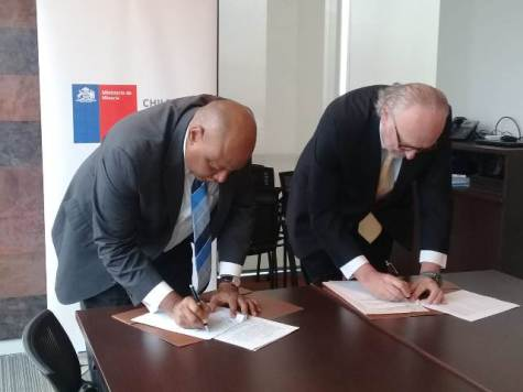 Minister of Natural Resources, Raphael Trotman and Chile's Minister of Mining, Baldo Prokurica, sign a Memorandum of Understanding (MOU), to provide a framework for the exchange of scientific and technical knowledge, concerning Earth Sciences and Mining.