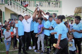 Minister of Social Cohesion, with responsibility for Sport, Dr. George Norton celebrating with Visionary Youth Club after their victory against Houston Club