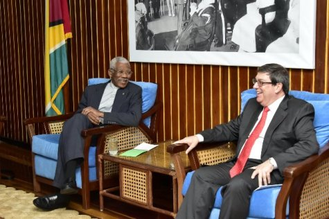 President David Granger shares a light moment with Cuban Minister of Foreign Affairs, Mr. Bruno Rodriguez Parrilla during their meeting.