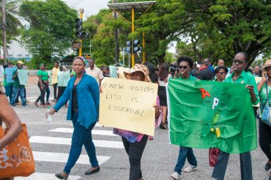 Protesters on Lamaha and Main streets call for house to house registration