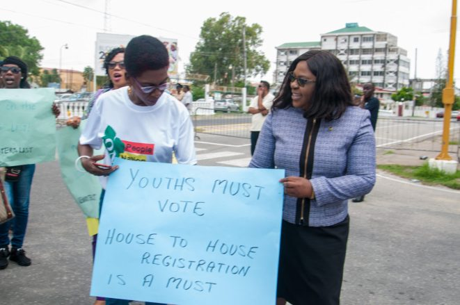 Minster of Foreign Affairs, Dr. Karen Cummings joins the protesters calling for house to house registration