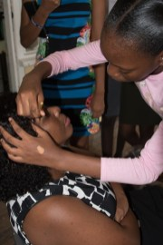 I'm getting my 'face beat' Her Worship, Waneka Arrindell, with young cosmetologist, Eden Noel.