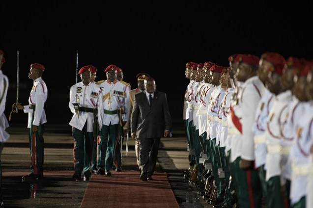President of the Republic of Ghana, Nana Akufo-Addo inspects the Guard of Honour upon his arrival to Guyana, at the Cheddi Jagan International Airport (CJIA).