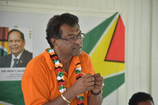 Minister of Public Security Khemraj Ramjattan addressing the resident at the meeting.
