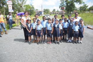 Minister of Public Health Volda Lawrence and Minister within the Ministry of Indigenous Peoples' Affairs Valerie Garrido-Lowe along with several students of the St. Mary's Primary School, Region 7.