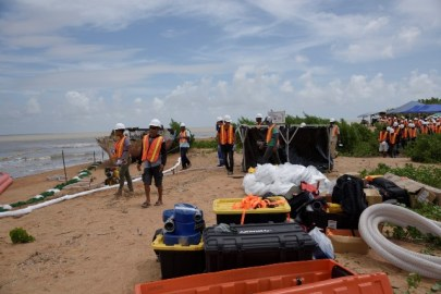 Scenes from the oil spill demonstration exercise at Waini Point, Shell Beach Protected Area in the Barima-Waini.