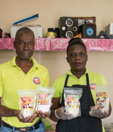 Lawrence Braithwaite and his assistant Rudo Bess display some of his instant products.