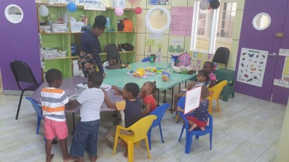 Toddlers playing in one of the play areas within the Early Childhood Centre