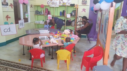 Toddlers and caregivers in one of the play areas within the Early Childhood Development Centre