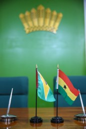 Flags of Guyana and Ghana.