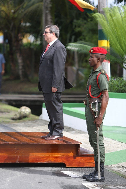 Cuba's Foreign Minister, Bruno Gonzalez Parrilla at Guyana's Independence Arch.