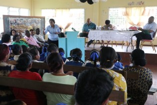 Minister of Telecommunications, Catherine Hughes speak with residents of Itabali during a community outreach on Wednesday. Looking on at the head table is Chief Executive Officer of the Guyana Water Incorporated, Dr. Richard Van West-Charles, Minister of Social Protection, Amna Ally and Director General of the Ministry of the Presidency, Joseph Harmon.