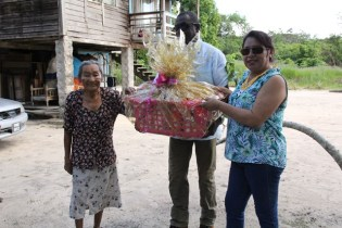 Minister of State, Dawn Hastings-Williams presents a hamper to Verna Cornelius.