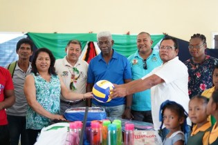 Minister of Indigenous Peoples' Affairs, Sydney Allicock and Minister of State, Dawn Hastings-Williams handing over the farming tools and sport gear to the residents of Sebai.
